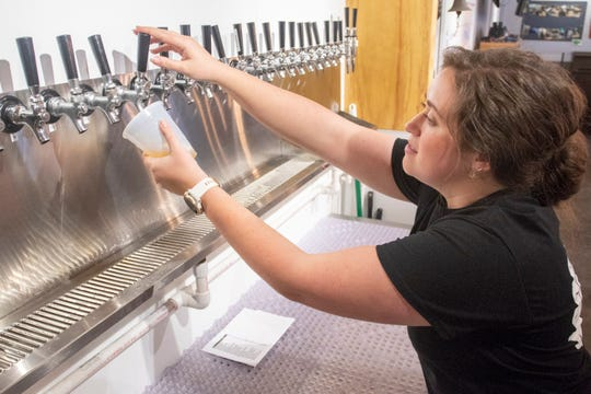 Bartender Jacqueline Vitali pours a beer during the soft opening at Coastal County Brewing on E. Olive Road in Pensacola on Wednesday, March 11, 2020.  The Grand opening is on March 14th.