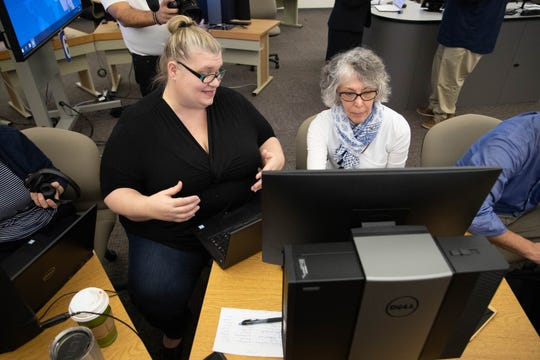 UWF instructors collaborate in transitioning all courses to be taught online in the wake of the COVID-19 outbreak in the Information Technology Center on March 12, 2020.