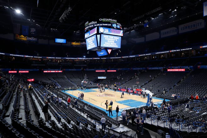 Fans leave after an announcement that the Oklahoma City Thunder vs. Utah Jazz game is canceled just before the tip off at Chesapeake Energy Arena.