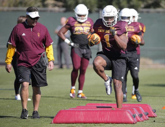 DeaMonte Trayanum (1) is one of two freshman running backs who are in contention to replace Eno Benjamin as ASU's feature back in 2020.