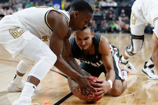 Colorado's McKinley Wright IV, left, and Washington State's Isaac Bonton scramble for the ball during the first half of an NCAA college basketball game in the first round of the Pac-12 men's tournament Wednesday, March 11, 2020, in Las Vegas. (AP Photo/John Locher)
