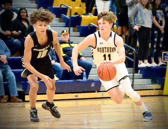 Port Huron Northern's James DeLong dribbles against L'Anse Creuse North during a Division 1 boys basketball district semifinal game on Wednesday, March 11, 2020.