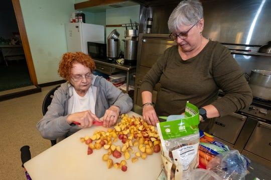 Noreen Wright, left, dices potatoes with Claudia Stober Wednesday, March 11, 2020, at Grace Episcopal Church in Port Huron.