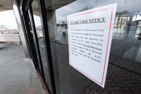 A sign on the door of the Municipal Office Center in Port Huron discourages visitors from conducting business in the building to help quell the spread of Coronavirus. In addition, the city announced that events with attendance over 100 at McMorran Theatre and Arena will be canceled until April 15.