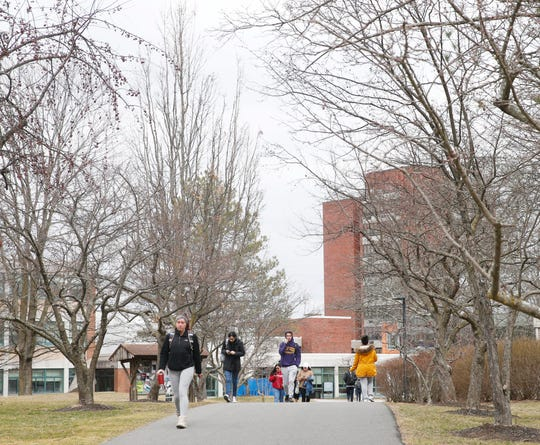 Students walk to class at SUNY New Paltz campus on March 12, 2020.