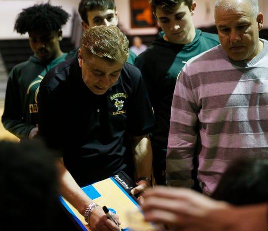 Hastings coach Bob Delle Bovi draws up a play for his boys basketball team during a Class B regional semifinal against Marlboro High School on March 11.
