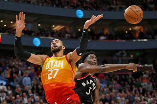 Toronto Raptors forward OG Anunoby (3) knocks the ball from Utah Jazz center Rudy Gobert (27) as he drives to the basket in the second half during an NBA basketball game, Monday, March 9, 2020, in Salt Lake City. (AP Photo/Rick Bowmer)