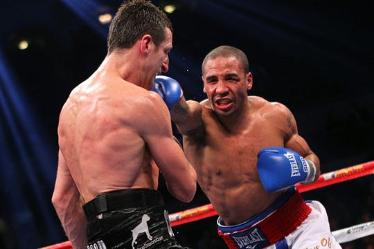 Andre Ward, right, connects against Carl Froch during their 12-round WBA/WBC super middleweight championship fight in December 2011.
