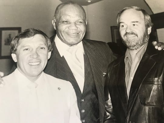 Sam Macias, left, will be inducted into the Nevada Boxing Hall of Fame this summer. Duane Ford is on the right. Former heavyweight champion jersey Joe Walcott is in the middle.