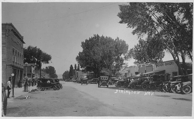 Looking northeast from the location of Lee's boarding house. The Nevada Bakery was once the Downey Saloon. Today this would be the southern section of the Yerington Inn. On the left is the IOOF brick building where the Bennett Store stood. Bennett's store burned to the ground in 1890. Issac Sims had his blacksmith shop where the big cottonwood tree stands in the middle of the photo.