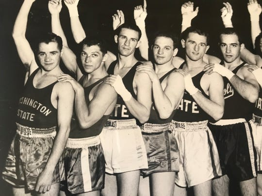 Sam Macia, second from left, is shown after winning at the Pacific Coast Intercollegiate Boxing champions  in Memorial Stadium in Sacramento in 1956.