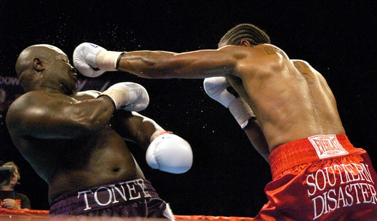 James Toney just barely ducks a punch by Dominick Guinn during their fight at the Reno Events Center ion Oct 3, 2005. Toney won the decision.