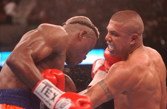 Fernando Vargas of Oxnard, Calif., right, and Raymond Joval of the Netherlands exchange punches in the sixth round of a middleweight fight on March 26, 2005, in Corpus Christi, Texas.