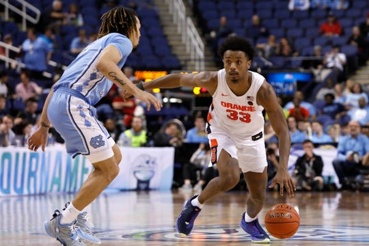 North Carolina guard Cole Anthony (2) guards Syracuse forward Elijah Hughes (33) during the second half of an NCAA college basketball game at the Atlantic Coast Conference tournament in Greensboro, N.C., Wednesday, March 11, 2020. Hughes scored 27 points in Syracuse's 81-53 victory.