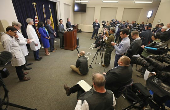 Monroe County Public Health Commissioner Dr. Michael Mendoza, at the podium, said at a news conference on Thursday, March 12, 2020, that he was recommending no gatherings larger than 50 people. The crowd of journalists and onlookers came close to surpassing that figure.