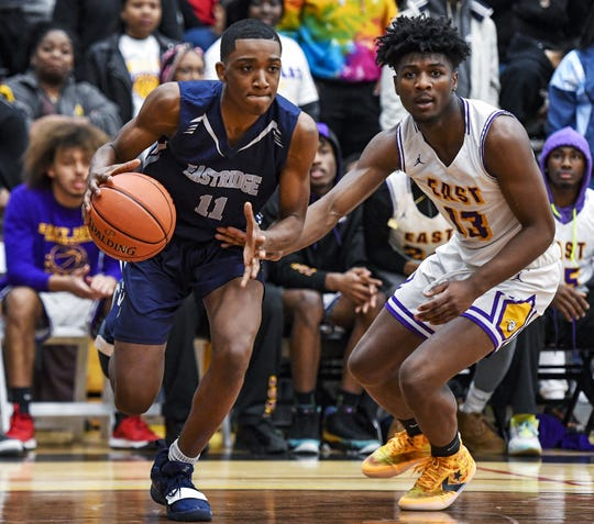 Eastridge's Ellington Hall, left, drives the base line past East's Kai McCullough during the Class A state qualifier play-in game at Edison Tech High School, Wednesday, Mar. 11, 2020. East advanced to the Class A Far West Regional with a 71-64 win over Eastridge.