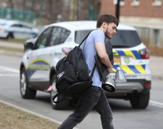 Students who didn't go away for spring break prepare to pack up their dorm rooms and leave on March 12, 2020.  University of Rochester is now having students who can move off campus and go home, taking their courses online for the rest of the year. Noah Neale, 21, of Greece brings his belongings to his car as he prepares to leave his on-campus housing.  Neale is a junior.