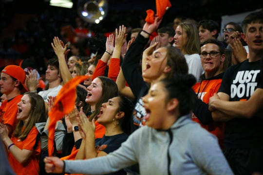 Silverton fans react as Nathan Brown, 11, hits a shot at the buzzer to end the third quarter as they take on Willamette during the OSAA Class 5A boys basketball state tournament at the Gill Coliseum in Corvallis, March 11, 2020.