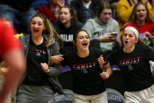 South Salem players react to a three-pointer during the OSAA Class 6A basketball tournament at the Chiles Center on the University of Portland campus on March 11, 2020.