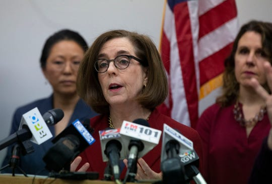 Oregon Governor Kate Brown speaks during a press conference with state and local government officials March 12, 2020, in Portland to talk about coronavirus plans and protocols in the state.