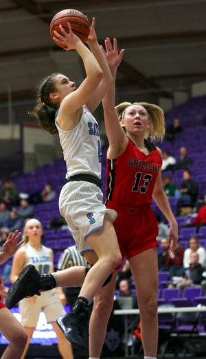 South's Hilary James, 2, scores a lay-up during their OSAA Class 6A basketball tournament against McMinnville at the Chiles Center on the University of Portland campus on March 11, 2020.