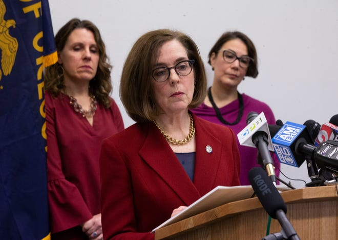 Oregon Gov. Kate Brown speaks during a press conference with state and local government officials March 12, 2020, about coronavirus plans and protocols in the state.