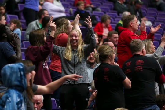 South Salem fans react during their team's OSAA Class 6A basketball tournament against McMinnville at the Chiles Center on the University of Portland campus on March 11, 2020.