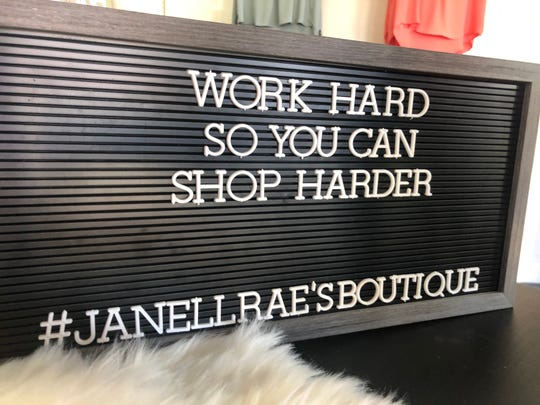Sign posted at Janell Rae's Boutique.