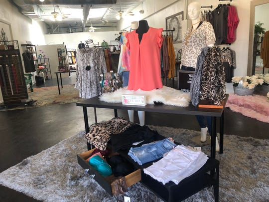 Spring blouses and shorts for sale at Janell Rae's Boutique.