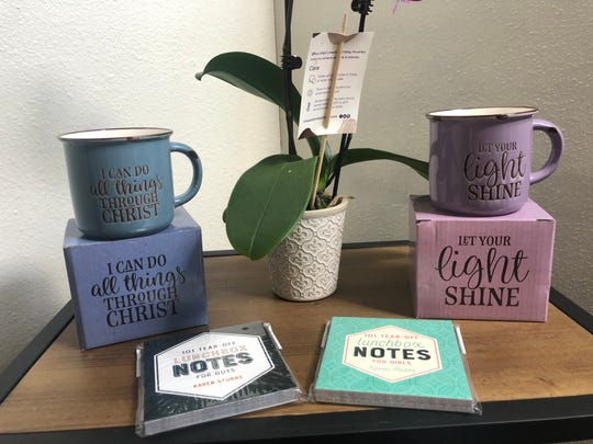 Mugs and notepads fill Janell Rae's Boutique's religious section along with children's books and cards.