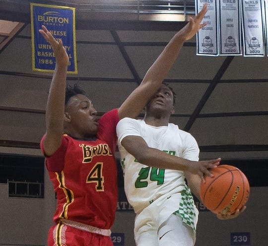 Bossier's Lakavin Thomas goes up for a bucket against Brusly in Thursday's LHSAA Class 3A semifinals.