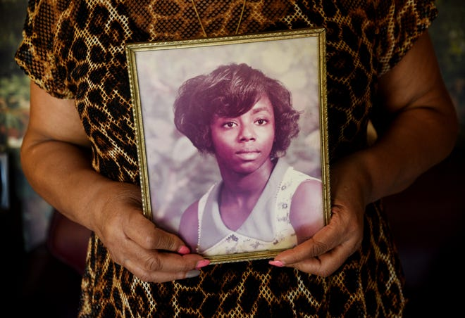 Brenda Spikes holds a photo of Juanita Jones in early March 2020 for a photograph. Jones was killed in the 80s while working at a Circle K. Her murder remains unsolved.