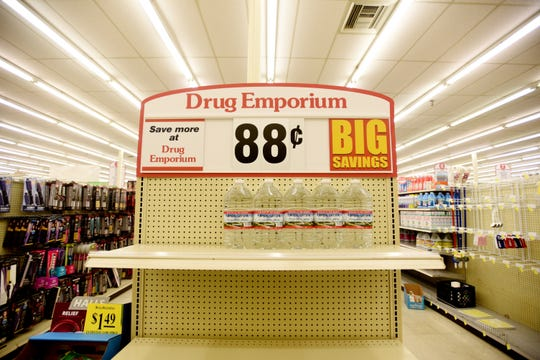 Water is selling fast at Drug Emporium Thursday afternoon, March 13, 2020.