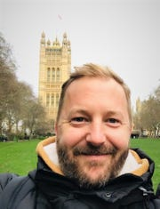 Eric Motzko, 1998 graduate of Apollo High School, is pictured Feb. 1 in London while on vacation from Shanghai American School in China.