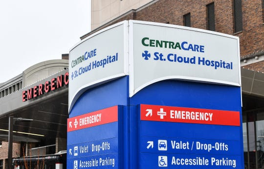 An entrance to the St. Cloud Hospital is pictured Thursday, March 12, 2020, in St. Cloud. CentraCare announced Thursday that visitors at all locations will no longer be allowed to protect patients and staff from the coronavirus.