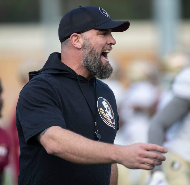 Florida State Seminoles strength and conditioning coach Josh Storms gets players warmed up. The Seminoles work on stepping up their game in the offseason during a spring practice, Thursday, March 12, 2020.