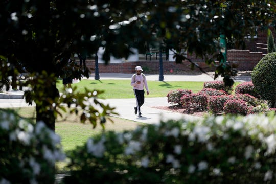 Florida A&M University students mill about campus Thursday, March 12, 2020, one day after it was announced that beginning March 23, after spring break, classes would be moved online for one week, resuming April 6, in response to concerns about the spread of coronavirus.