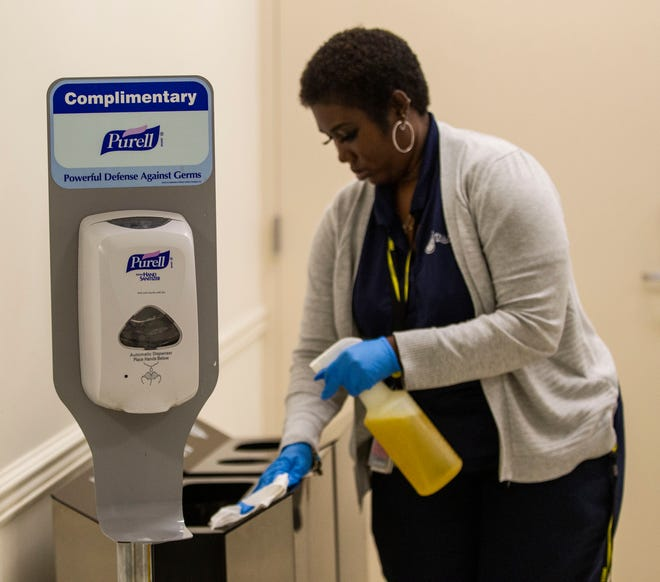 A hand sanitizing station is set up next to waste bins at the Tallahassee International Airport, Thursday, March 12, 2020.