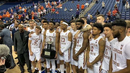 FSU basketball after being awarded the ACC title after the ACC Tournament was canceled in Greensboro, N.C.
