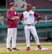 Florida State Seminoles Logan Lacey (32) talks with Florida State Seminoles head coach Mike Martin Jr. while at third base. The Florida State Seminoles hosted the Illinois State Redbirds, Wednesday, March 11, 2020.
