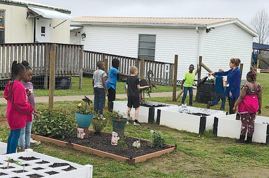 Thanks to volunteers, a new fence has gone up around the Conley Elementary School garden.