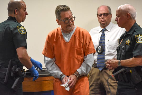 Daniel Sharp (center), a former Stuart guitar instructor, wipes off his hands after being fingerprinted during his sentencing before Martin County Circuit Judge Sherwood Bauer on Thursday, March 12, 2020, at the Martin County Courthouse in Stuart. Judge Sherwood Bauer ordered Daniel Sharp serve a total of 18 months in the Martin County Jail: 9 months for a conviction of misdemeanor battery, and 9 months for contributing to the delinquency of a minor. He also was ordered to serve five years of sex offender probation for his conviction of transfer or display of obscenity to a minor. Sharp was convicted of battery and contributing to the minor.