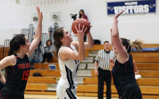 Putnam Valley's Eva Dechent (21) drives to the basket against Marlboro during the girls basketball regional playoff action at Putnam Valley High School March 11, 2020. Putnam Valley won the game 66-49.
