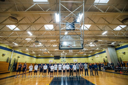 Horace Greeley and Newburgh Free Academy stand for the playing of the National Anthem during the Class AA state quarterfinal basketball game at Newburgh Free Academy in Newburgh, NY on Wednesday, March 11th, 2020. Horace Greeley defeated Newburgh 48-50. KELLY MARSH/FOR THE TIMES HERALD-RECORD