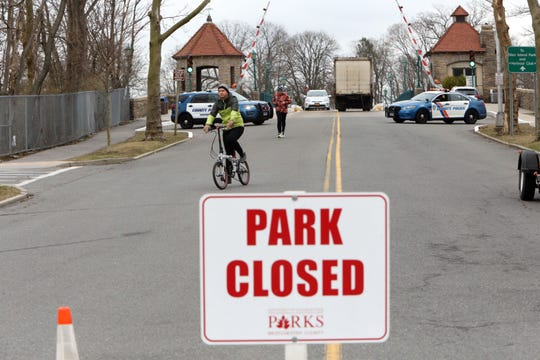 Park-goers are turned away at the entrance to Glen Island Park in New Rochelle, NY,  by Westchester County Police while preparations are underway to transform the space to a coronavirus testing area March 12, 2020.