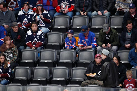 Empty seats are seen in the lower bowl of Pepsi Center as the Colorado Avalanche play the New York Rangers in the first period of an NHL hockey game Wednesday, March 11, 2020, in Denver.