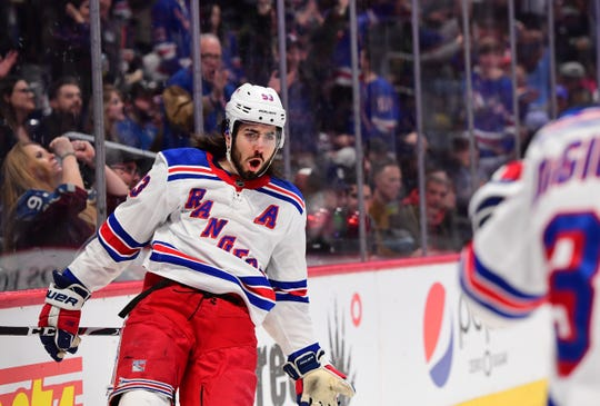 Mar 11, 2020; Denver, Colorado, USA; New York Rangers center Mika Zibanejad (93) reacts to his goal in the first period against the Colorado Avalanche at the Pepsi Center.
