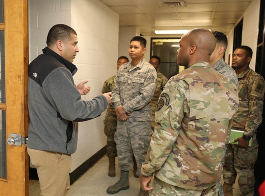 Daniel Bonnet, director of New Rochelle CAP, organizes National Guard members, March 12, 2020. Guard members arrived to help distribute food and clean institutions in the 1-mile-radius coronavirus containment zone. CAP is south of the containment zone.