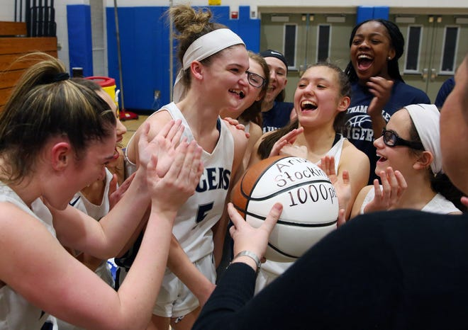 Putnam Valley's players gather around Arianna Stockinger to celebrate her scoring her 1,000th career point after Wednesday's state Class B subregional game against Marlboro at Putnam Valley High School on March 11, 2020.