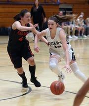 Putnam Valley's Keli Venezia (13) drives around Marlboro's Elizabeth Leduc (2) during girls basketball regional playoff action at Putnam Valley High School March 11, 2020.